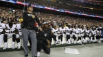 Some members of the Oakland Raiders kneel during the playing of the National Anthem before an NFL football game against the Washington Redskins in Landover, Md. on Sunday, Sept. 24, 2017. (AP / Alex Brandon)