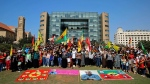 Supporters of the Kurdistan Workers' Party, known as the PKK, take part in a demonstration demanding the release of Kurdish guerrilla leader Abdullah Ocalan, seen on banner in foreground, in front of the United Nations Headquarters in Beirut, Lebanon, Sunday, Sept. 24, 2017. Ocalan, the founder of the PKK, was captured in Kenya after being forced to leave a Greek diplomatic mission there in 1999, and was sentenced to death for leading an insurgency fighting for Kurdish autonomy in Turkey's southeast that has claimed tens of thousands of lives since 1984. (AP Photo/Bilal Hussein)