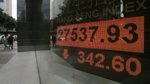 An electronic board shows Hong Kong share index outside a local bank in Hong Kong on Monday, Sept. 25, 2017. (AP / Vincent Yu)