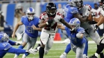 Atlanta Falcons running back Devonta Freeman rushes through the Detroit Lions defence during the first half of an NFL football game in Detroit on Sunday, Sept. 24, 2017. (AP / Rick Osentoski)