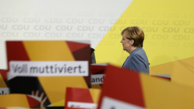 German Chancellor Angela Merkel enters the stage at the headquarters of the Christian Democratic Union CDU in Berlin, Germany after the parliamentary election on Sunday, Sept. 24, 2017. (AP / Michael Sohn)