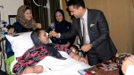 "Eman Abdul Atti, an Egyptian once known as ""the world's heaviest woman"" receives a piece of cake from Dr. Shamsheer Vayalil during her 37th birthday party at the Burjeel Hospital in Abu Dhabi, United Arab Emirates on Sept.11, 2017. (Burjeel Hospital via AP)"