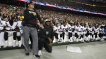 Members of the Oakland Raiders kneel during the U.S. national anthem in Landover, Md., on Sept. 24, 2017. (Alex Brandon / AP)