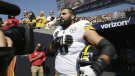 Pittsburgh Steelers offensive tackle and former Army Ranger Alejandro Villanueva (78) stands alone during the national anthem before an NFL football game against the Chicago Bears, on Sept. 24, 2017, in Chicago. (Nam Y. Huh / AP)