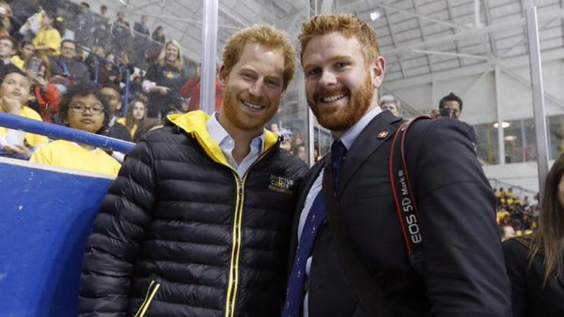 Prince Harry poses with Adam Scotti