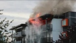 Fire tore through an apartment complex in Burnaby Sunday evening.