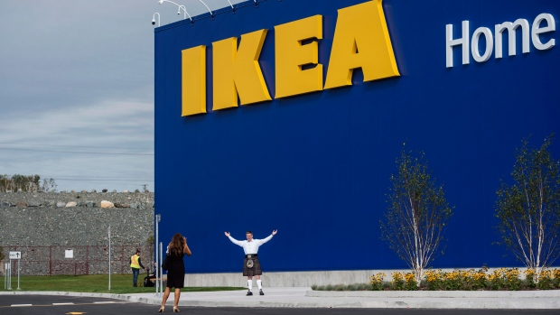 A man in a kilt poses in front of the new IKEA Halifax store in Dartmouth, N.S. on Monday, September 25, 2017. Ikea is getting ready to officially open its first Atlantic Canadian store this week as thousands from across the region are expected to descend upon the popular Swedish furniture chain's new location. (THE CANADIAN PRESS/Darren Calabrese)