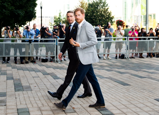 Prince Harry, right, arrives and greets Michael Burns, CEO of 2017 Invictus Games before speaking at the Canadian Institute for Military and Veterans Mental Health Research conference (CIMVHR) in Toronto on Monday, September 25, 2017. THE CANADIAN PRESS/Nathan Denette