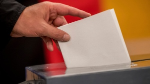 A man casts his vote in the German parliament election in Berlin Sunday, Sept. 24, 2017. (Michael Kappeler/dpa via AP)