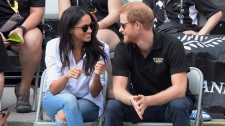 Prince Harry and his girlfriend Meghan Markle attend a wheelchair tennis event at the Invictus Games in Toronto, Sept.25, 2017. THE CANADIAN PRESS/Nathan Denette