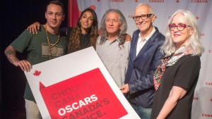 "Actors, from left, Samian, Naiade Aoun, and Wahiakeron Gilbert, as well as producer Roger Frappier, and Telefilm Canada's executive director Carolle Brabant, pose for photos after the film ""Hochelaga, Land of Souls,"" was named as Canada's entry in the race for the 2018 Best Foreign Language Film Oscar on Sept. 25, 2017 in Montreal. (THE CANADIAN PRESS / Ryan Remiorz)"