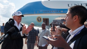 FILE - In this Thursday, Sept. 14, 2017, file photo, President Donald Trump talks with reporters after landing on Air Force One, in Fort Myers, Fla. (AP Photo/Evan Vucci)