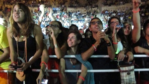 FILE - In this Friday, Sept. 14, 2012 photo, fans of the Lebanese group Mashrou Leila' cheer as the band performs in the ancient Roman amphitheater in the Jordanian capital Amman. (AP Photo/Diaa Hadid, File)