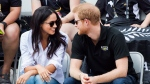 Prince Harry and his girlfriend Meghan Markle attend the wheelchair tennis competition during the Invictus Games in Toronto on Monday, September 25, 2017. This is Prince Harry's first public appearance with Markle. THE CANADIAN PRESS/Nathan Denette