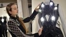 A woman straightens a creation by Dutch designer Anouk Wipprecht. (Britta Pedersen/DPA)