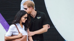 Prince Harry arrives with his girlfriend Meghan Markle to a wheelchair tennis event during the Invictus Games in Toronto on September 25, 2017. (Nathan Denette/The Canadian Press)