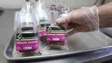 In this Sept. 26, 2014, file photo, smaller-dose pot-infused brownies are packaged at The Growing Kitchen in Boulder, Colo. (AP Photo/Brennan Linsley, File)