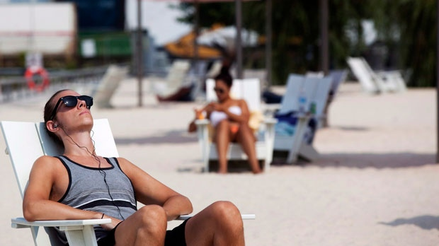 Andrew Fischer tans at Sugar Beach in Toronto on Friday, July 13, 2012. (The Canadian Press/Michelle Siu)