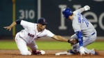 Toronto Blue Jays' Josh Donaldson avoids the tag from Boston Red Sox's Xander Bogaerts on his two-run double during the second inning of a baseball game in Boston on Monday, Sept. 25, 2017. (AP / Michael Dwyer)