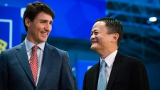 Prime Minister Justin Trudeau tours the market place with Alibaba Group founder Jack Ma at the Gateway Conference in Toronto on Monday, September 25, 2017.(Christopher Katsarov/THE CANADIAN PRESS)
