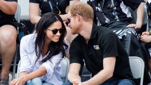 Prince Harry and his girlfriend Meghan Markle attend the wheelchair tennis competition at the Invictus Games in Toronto on Monday, Sept. 25, 2017. (Nathan Denette / THE CANADIAN PRESS)