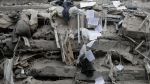 Documents tumble down past collapsed floors of a 7-storey building at the corner of Gabriel Mancera and Escocia streets in the Del Valle neighbourhood of Mexico City on Monday, Sept. 25, 2017. (AP / Rebecca Blackwell)