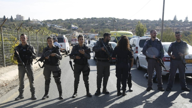 Israeli police blocks the road to Har Adar settlement near Jerusalem on Tuesday, Sept. 26, 2017. (AP / Mahmoud Illean)