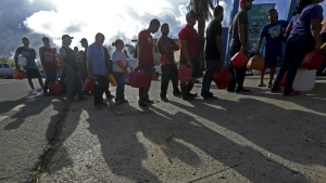 People wait in line for gas, in the aftermath of Hurricane Maria, in Aibonito, Puerto Rico on Monday, Sept. 25, 2017. (AP / Gerald Herbert)