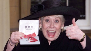 British actress Liz Dawn at Buckingham Palace after she received an MBE, in London, Oct. 24, 2000. (Sean Dempsey / PA via AP)