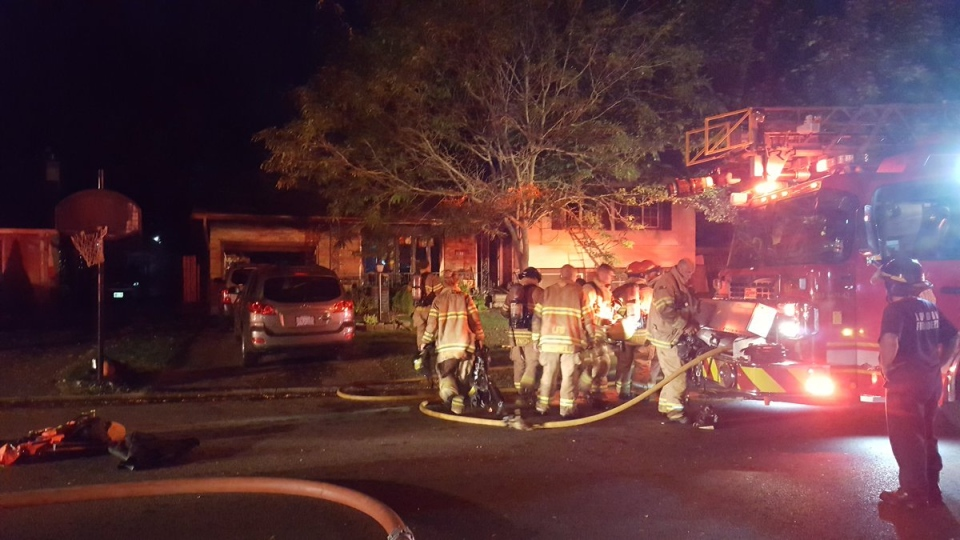 Fire crews on scene of a fire at 11 Wakefield Cres. in London, Ont, on Tuesday, September 26, 2017. (Justin Zadorsky / CTV London)