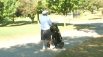 Not all golfers deterred by heat wave