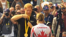 Prince Harry gives out medals in Toronto