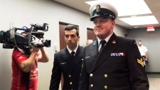 Accused Master Seaman Daniel Cooper, right, arrives for his standing court martial case in Halifax on Tuesday Sept. 26, 2017. Cooper faces one charge of sexual assault, and one charge of ill treatment of a subordinate, arising out of incidents that allegedly occurred in November 2015 on board HMCS Athabaskan near Rota, Spain. (THE CANADIAN PRESS/Ted Pritchard)