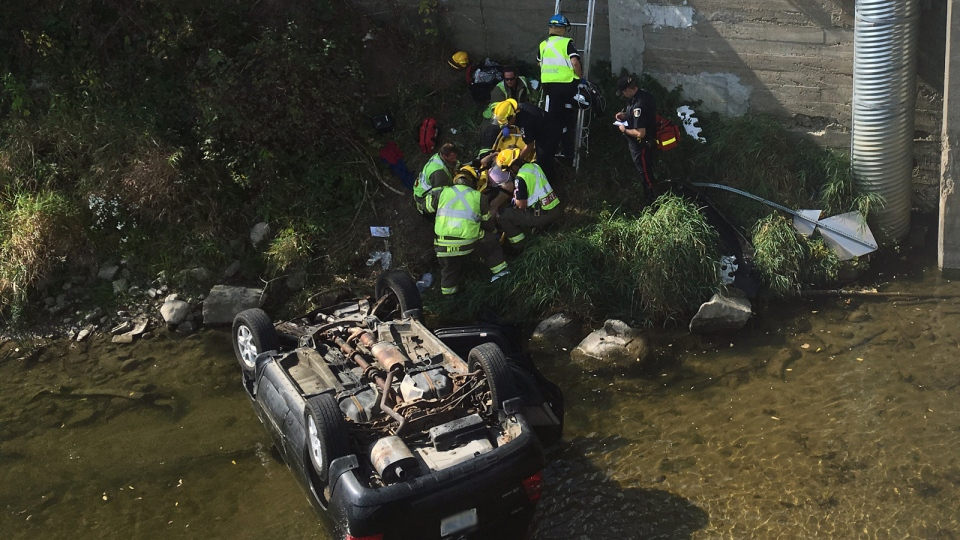 Emergency crews were called to the Bridgeport Bridge after a two-vehicle collision left an SUV in the Grand River on Tuesday, Sept. 26, 2017. (Dan Lauckner / CTV Kitchener)