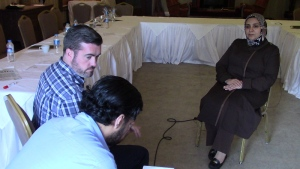 Bill Fortier (with a translator) interviews Ghazouah Almilagi, a journalist whose son was killed by a bomb in Syria.