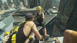 CTV Montreal reporter Annie DeMelt rappels down a building on Sept. 26, 2017