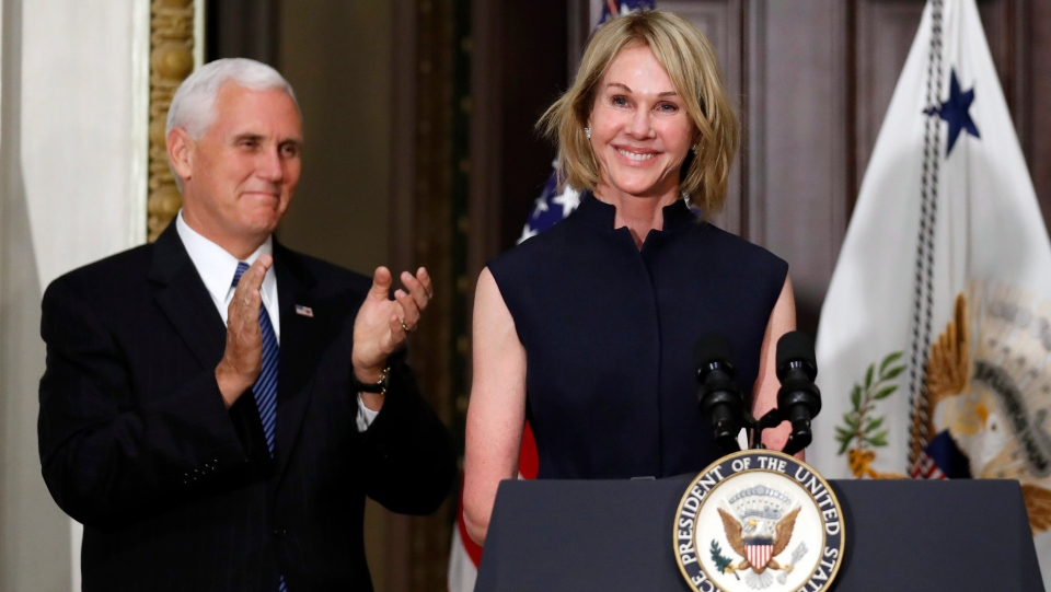 Vice President Mike Pence applauds as U.S. Ambassador to Canada Kelly Knight Craft concludes her remarks during her swearing in ceremony in the Indian Treaty Room in the Eisenhower Executive Office Building on the White House grounds, , in Washington, on Tuesday, Sept. 26, 2017. (AP Photo/Alex Brandon)