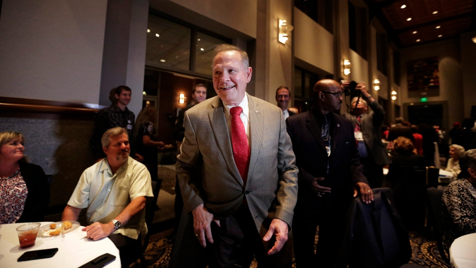 Former Alabama Chief Justice and U.S. Senate candidate Roy Moore, greets supporters before his election party, in Montgomery, Ala., on Tuesday, Sept. 26, 2017. (AP Photo/Brynn Anderson)