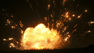 A powerful explosion is seen in the ammunition depot at a military base in Kalynivka, west of Kiev, Ukraine, early Wednesday, Sept. 27, 2017. (AP / Efrem Lukatsky)