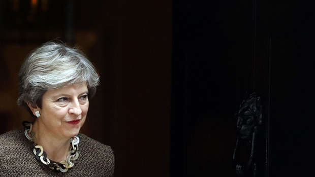 Theresa May walks out at 10 Downing Street