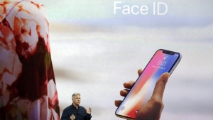 Apple's Phil Schiller announces the Face ID features of the new iPhone X, on , Sept. 12, 2017. (Marcio Jose Sanchez / AP)