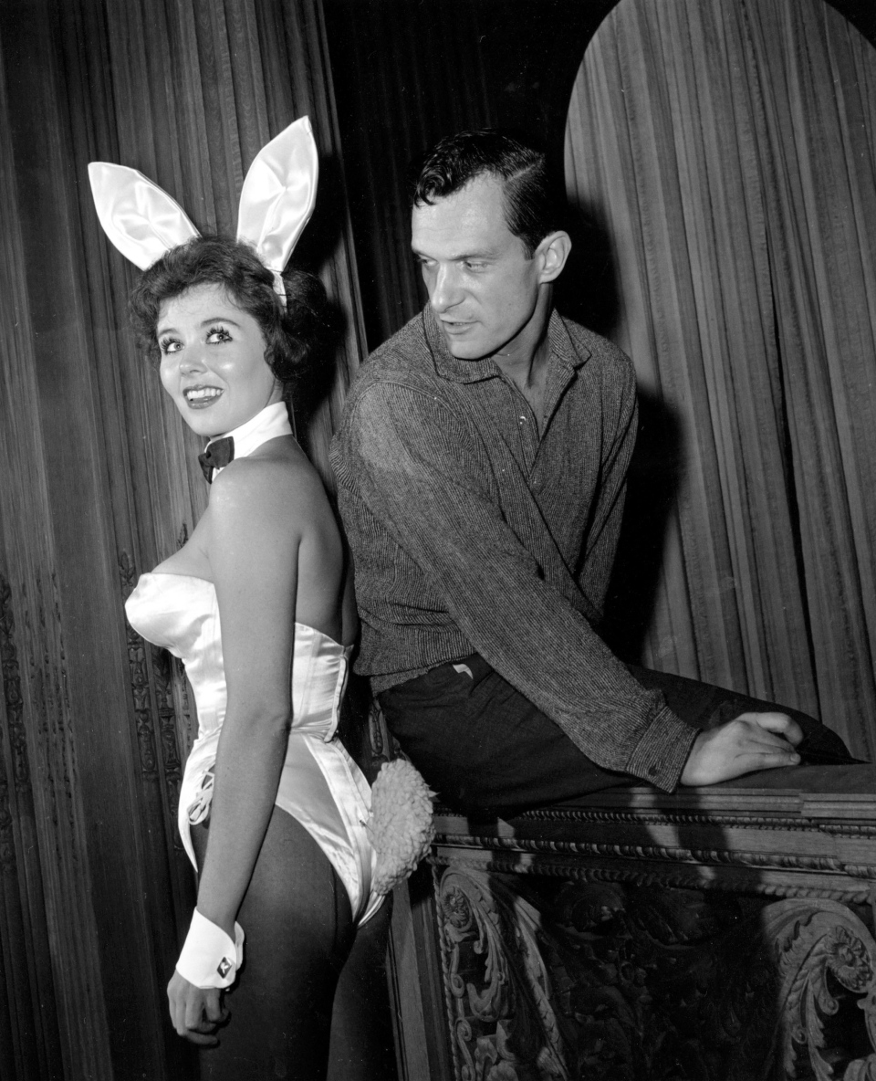 "Playboy magazine publisher Hugh Hefner poses with ""bunny-girl"" hostess Bonnie J. Halpin at Hefner's nightclub in Chicago, June 20, 1961. (AP Photo/Ed Kitch)"