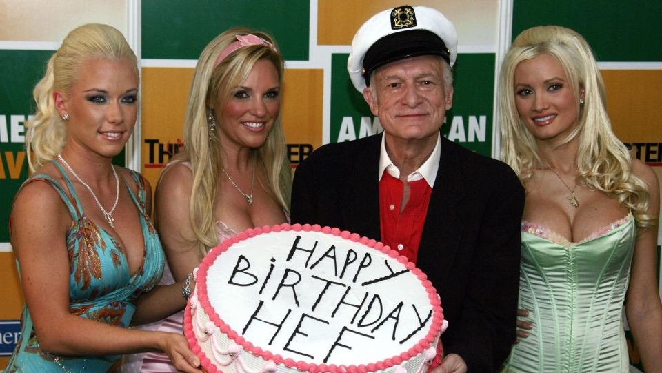 Playboy magazine founder Hugh Hefner, second right, holds a birthday cake with girlfriends Kendra Wilkinson, left, Bridget Marquardt, second left and Holly Madison, right, during a photocall to celebrate his 80th birthday at the 59th International film festival in Cannes, southern France Thursday, May 25, 2006. (AP Photo/Francois Mori)
