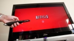 In this July 20, 2010 file photo, a person uses Netflix in Palo Alto, Calif. (AP Photo/Paul Sakuma, File)