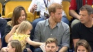 Two-year-old helping herself to Prince Harry's popcorn.  (ITV News)