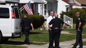 Police investigate at a home where two children were shot in Dearborn, Mich., Wednesday, Sept. 27, 2017. Police said the young children were wounded in the apparently accidental shooting at the home that was being used for childcare in suburban Detroit. (Tanya Moutzalias /The Ann Arbor News via AP)