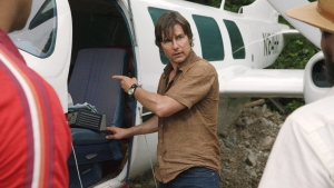 This image released by Universal Pictures shows Tom Cruise as Barry Seal in a scene from, 'American Made.' (David James / Universal Pictures via AP)