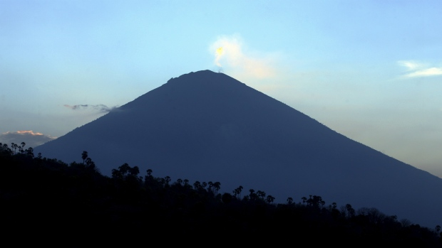 Over 130000 flee menacing volcano on Bali tourist island