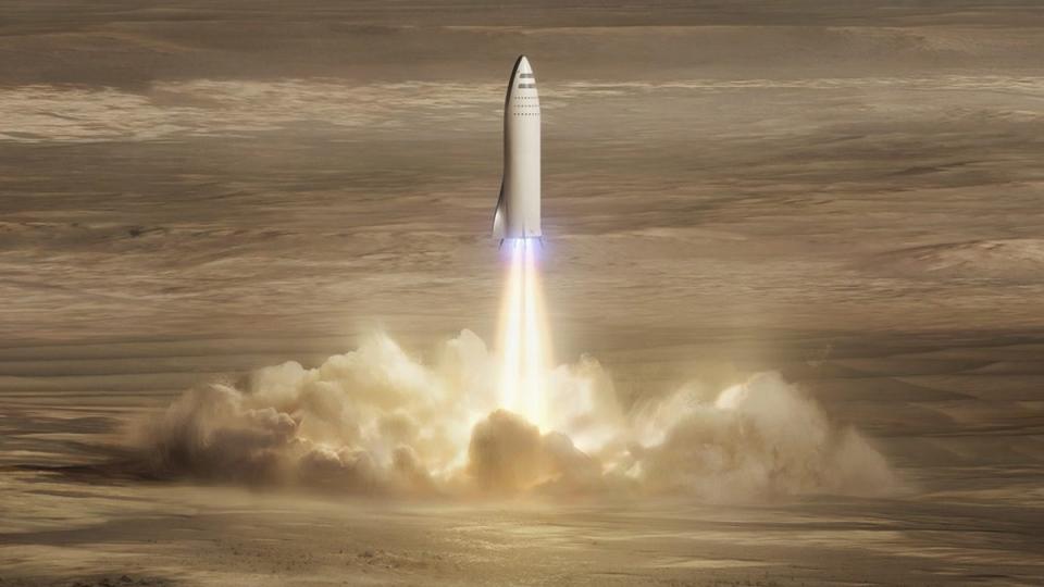 Artist's rendering of SpaceX's new mega-rocket design landing on Mars. (SpaceX via AP)