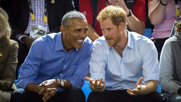 Former U.S. President Barack Obama and Prince Harry watch wheelchair basketball at the InvictusGames in Toronto on Friday, Sept. 29, 2017. THE CANADIAN PRESS / Chris Donovan